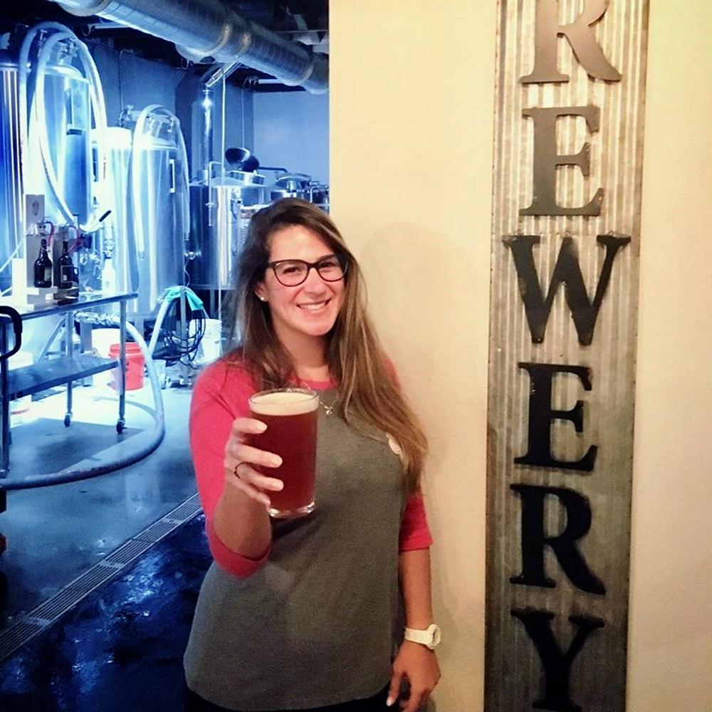 New Smyrna Beach Bartender Lola Tasting a Fresh Beer